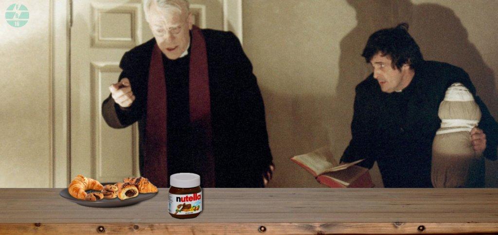 Un prete esorcista intento a estirpare il diabolico olio di palma da alcuni dolciumi. Il suo assistente osserva esterrefatto.